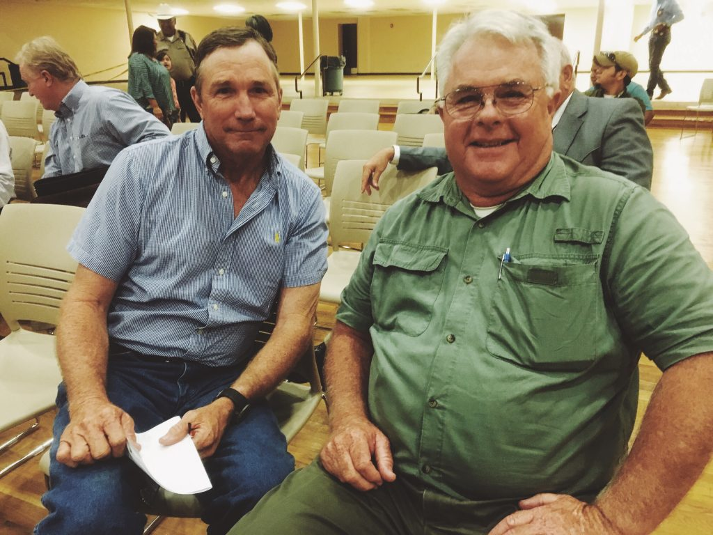 "Friends Mike Whitwell and E.T. Page continued their debate after the meeting. ""We always argue like this in Sunday school,"" Whitwell said of their 28-year friendship."